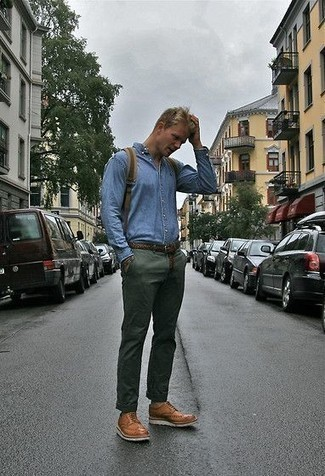 How to Wear a Light Blue Denim Shirt For Men: This combination of a light blue denim shirt and dark green chinos is super stylish and provides a casually dapper look. A trendy pair of tobacco leather brogues is a simple way to punch up this outfit.