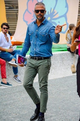 A blue denim shirt and olive chinos is a versatile pairing that will provide you with variety. A cool pair of black leather derby shoes is an easy way to upgrade your look. Stick with this one if you're hunting for a solid summertime look.
