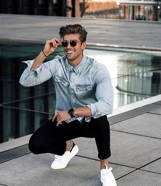 How to Wear a Light Blue Denim Shirt For Men: If you're searching for an off-duty and at the same time stylish ensemble, rock a light blue denim shirt with black chinos. For extra fashion points, complete this outfit with a pair of white and black canvas low top sneakers.