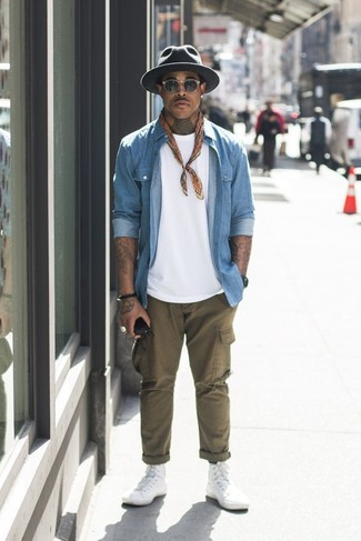 White Canvas High Top Sneakers Outfits For Men: Nail the cool and casual getup by opting for a light blue denim shirt and olive cargo pants. White canvas high top sneakers are an effective way to add a dash of stylish nonchalance to this outfit.