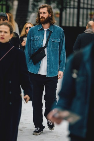 How to Wear a Blue Denim Shirt For Men: For something more on the casual side, try pairing a blue denim shirt with navy wool chinos. When not sure as to the footwear, complement your outfit with a pair of black canvas low top sneakers.