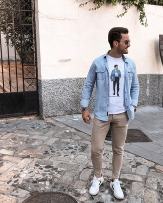 Light Blue Denim Shirt Outfits For Men: Go for a light blue denim shirt and khaki chinos to achieve new levels in your personal style. Complement this outfit with white and green leather low top sneakers and the whole look will come together quite nicely.