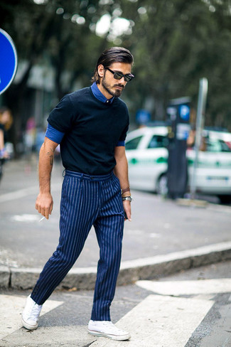 Consider wearing a blue denim shirt and striped suit pants for a sharp, fashionable look. White low top sneakers are the right shoes here to get you noticed.