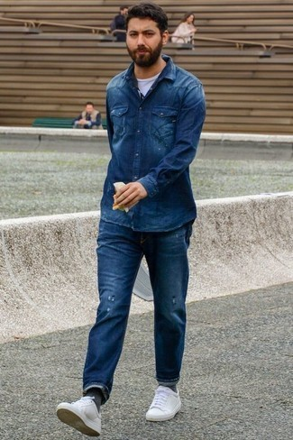 How to Wear White Leather Low Top Sneakers In Your 30s In a Relaxed Way For Men: A navy denim shirt and navy ripped jeans are a cool getup to have in your day-to-day routine. White leather low top sneakers are an effortless way to breathe an added touch of style into this outfit.