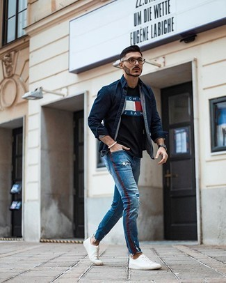 Bracelet Outfits For Men: This urban combination of a navy denim shirt and a bracelet is extremely easy to throw together in next to no time, helping you look amazing and prepared for anything without spending too much time digging through your wardrobe. And if you wish to instantly step up your ensemble with footwear, why not complement your ensemble with a pair of white canvas low top sneakers?
