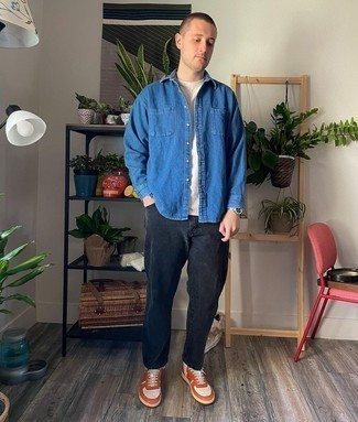 Denim Shirt Outfits For Men: This relaxed pairing of a denim shirt and black jeans is a foolproof option when you need to look sharp in a flash. Orange leather low top sneakers are a nice option to round off this ensemble.