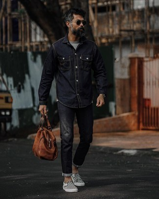 Black and White Check Canvas Slip-on Sneakers Outfits For Men: A navy denim shirt and black jeans are veritable menswear essentials if you're picking out a casual wardrobe that matches up to the highest style standards. Black and white check canvas slip-on sneakers make this ensemble complete.