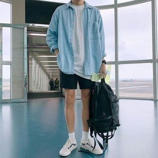 How to Wear a Bag For Men: This combo of a light blue denim shirt and a bag looks awesome and instantly makes you look cool. For a sleeker vibe, add white and navy low top sneakers to this getup.