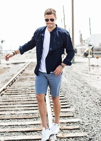 How to Wear a Black Beaded Bracelet For Men: A navy denim shirt and a black beaded bracelet are both versatile menswear essentials that will integrate nicely within your daily fashion mix. Add a pair of white canvas low top sneakers to the mix to effortlessly dial up the fashion factor of your look.