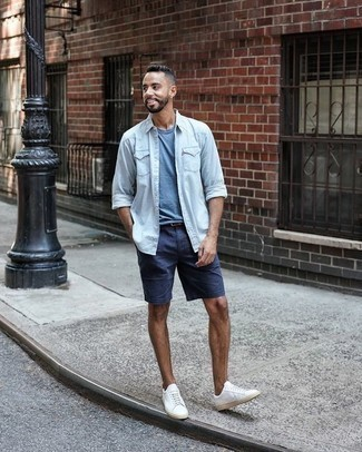How to Wear a Dark Brown Leather Belt For Men: This combination of a light blue denim shirt and a dark brown leather belt is the perfect base for a variety of dapper getups. Balance out this outfit with a classier kind of shoes, like these white canvas low top sneakers.
