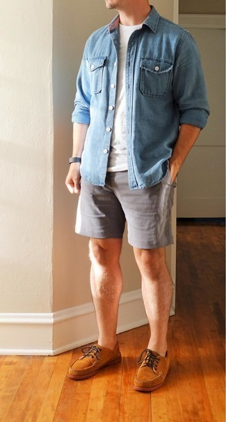 Denim Shirt Outfits For Men: If you like casual combos, then you'll love this pairing of a denim shirt and grey shorts. A pair of tobacco suede boat shoes will be the ideal complement to this outfit.