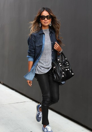 A navy blue denim shirt with black leather slim jeans has become an essential combination for many style-conscious girls. Go for a pair of blue low top sneakers for a more relaxed aesthetic.