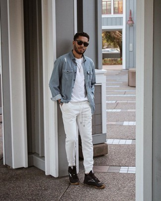 Sweatpants Outfits For Men: You'll be surprised at how extremely easy it is for any gentleman to pull together a relaxed getup like this. Just a light blue denim shirt worn with sweatpants. If you want to break out of the mold a little, introduce a pair of black and white athletic shoes to the mix.
