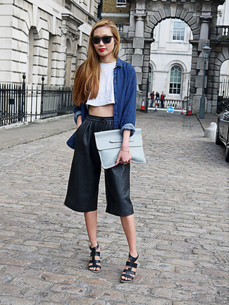Let everyone know that you know a thing or two about style in a navy denim shirt and black culottes. Finish off your look with black leather wedge sandals.