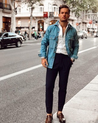 Denim Shirt Outfits For Men: For a casual getup, try teaming a denim shirt with navy chinos — these items fit perfectly together. If you wish to immediately up the ante of this look with a pair of shoes, introduce a pair of dark brown leather monks to the equation.