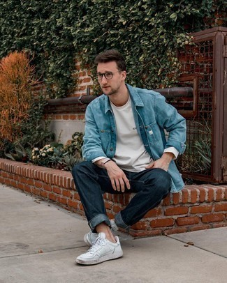 Men's Outfits 2020: This pairing of a light blue denim shirt and navy jeans looks amazing and makes any gent look instantly cooler. Our favorite of an endless number of ways to complete this ensemble is a pair of white leather low top sneakers.