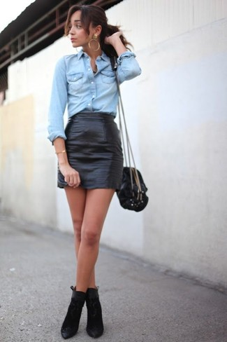 Wear a light blue denim shirt with a black leather mini skirt to achieve a chic look. Black suede booties will add a touch of polish to an otherwise low-key look.