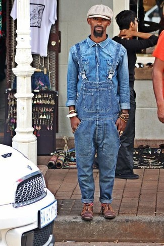 How to wear: blue denim shirt, blue denim overalls, brown leather oxford shoes, grey flat cap