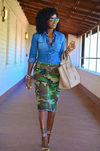 Team a blue denim shirt with a green camouflage pencil skirt for a comfortable outfit that's also put together nicely. For the maximum chicness rock a pair of grey leather heeled sandals.