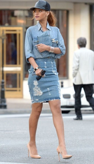 If you're in search of a casual yet stylish ensemble, consider wearing a light blue denim shirt and a blue ripped denim pencil skirt. Both garments are totally comfy and will look fabulous together. Elevate this look with tan leather pumps. So when spring is in the air, you'll find this ensemble to be your everything.