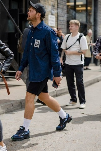 How to Wear Black Shorts For Men: This pairing of a navy print denim shirt and black shorts is hard proof that a safe casual look can still be razor-sharp. On the fence about how to finish off? Go for navy athletic shoes to switch things up.
