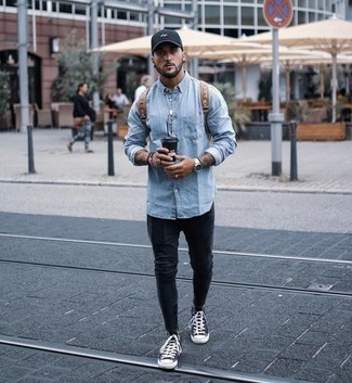 How to Wear a Light Blue Denim Shirt For Men: If you're on the lookout for a bold casual and at the same time stylish outfit, team a light blue denim shirt with charcoal skinny jeans. Introduce a pair of navy and white canvas high top sneakers to your outfit and you're all done and looking killer.