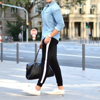 How to wear: light blue denim shirt, black and white sweatpants, white low top sneakers, black leather holdall