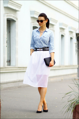 Rock a light blue denim shirt with a white cutout midi skirt for a Sunday lunch with friends. Complement this look with black suede pumps.