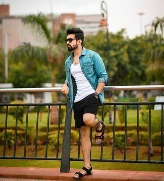 How to Wear Black Shorts For Men: Dress in an aquamarine denim shirt and black shorts if you want to look casually stylish without too much work. Black canvas sandals add a new flavor to an otherwise standard look.
