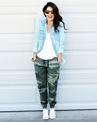 Consider wearing a light blue denim shirt and hunter green camouflage jogging pants for an easy to wear look. A pair of white low top sneakers will seamlessly integrate within a variety of outfits.