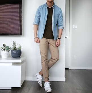 Light Blue Denim Shirt Outfits For Men: Why not choose a light blue denim shirt and khaki chinos? Both of these items are very comfortable and will look cool paired together. When it comes to footwear, this ensemble pairs nicely with white canvas low top sneakers.