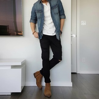 Blue Denim Shirt Warm Weather Outfits For Men: A blue denim shirt and black ripped jeans are an easy way to introduce toned down dapperness into your current casual repertoire. And if you need to effortlessly step up your look with one item, why not complete this outfit with a pair of brown suede casual boots?