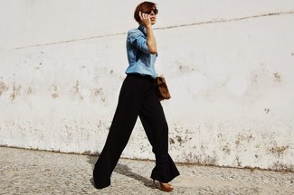 How to Wear a Light Blue Denim Shirt For Women: Flaunt your styling credentials by pairing a light blue denim shirt and black wide leg pants for a laid-back getup. For maximum style, complement this ensemble with a pair of brown leather heeled sandals.