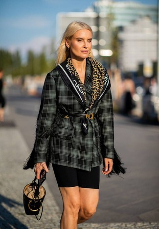 How to wear: black and white plaid double breasted blazer, black bike shorts, black leather bucket bag, black leather waist belt