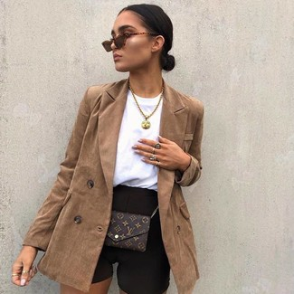 How to wear: brown double breasted blazer, black bike shorts, dark brown print leather crossbody bag, brown sunglasses