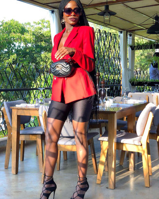 How to wear: red double breasted blazer, black bike shorts, black suede heeled sandals, black quilted leather fanny pack