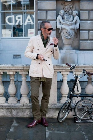 How to Wear a Scarf For Men: A beige double breasted blazer and a scarf? This is an easy-to-create look that any guy could rock a version of on a day-to-day basis. If you need to effortlessly level up your ensemble with a pair of shoes, make burgundy leather chelsea boots your footwear choice.
