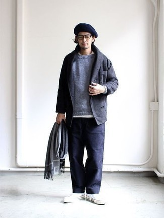 Men's Outfits 2021: This pairing of a charcoal double breasted blazer and navy chinos strikes an interesting balance between formal and relaxed. Loosen things up and complete this outfit with a pair of white canvas low top sneakers.