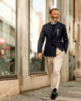 How to wear: navy double breasted blazer, black crew-neck sweater, beige dress pants, black suede derby shoes