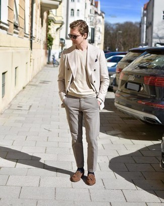 Beige Crew-neck Sweater Outfits For Men: This sophisticated pairing of a beige crew-neck sweater and grey dress pants is a frequent choice among the sartorially savvy chaps. Add brown suede tassel loafers to the equation and the whole look will come together perfectly.