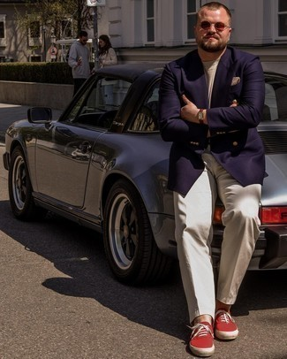Men's Outfits 2021: Consider wearing a navy double breasted blazer and beige dress pants - this look will definitely make a sartorial statement. If you want to easily dress down your look with a pair of shoes, why not complete your outfit with red canvas low top sneakers?