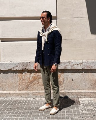 Beige Crew-neck Sweater Outfits For Men After 40: Undeniable proof that a beige crew-neck sweater and olive chinos look awesome if you wear them together in an off-duty look. White canvas espadrilles act as the glue that will pull your getup together. Like this style idea for a mature man?
