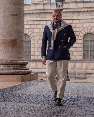 Men's Outfits 2021: This look clearly illustrates it pays to invest in such timeless menswear items as a navy double breasted blazer and beige dress pants. A pair of black leather tassel loafers adds just the right amount of casualness to this look.