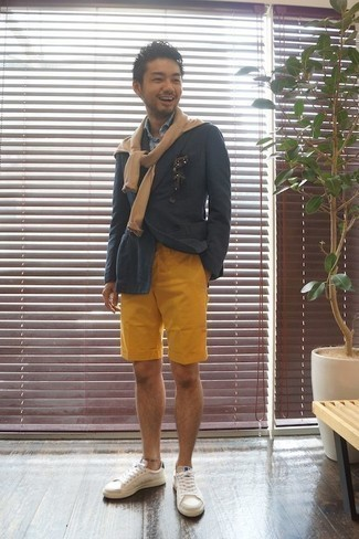 How to Wear Mustard Shorts For Men: Perfect the casually classic menswear style by wearing a navy double breasted blazer and mustard shorts. Let your styling credentials truly shine by complementing this outfit with a pair of white leather low top sneakers.