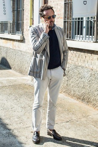 How to Wear a White and Navy Vertical Striped Long Sleeve Shirt For Men: For a casually dapper look, pair a white and navy vertical striped long sleeve shirt with white chinos — these items work really well together. If you want to immediately perk up your ensemble with shoes, complete this look with a pair of dark brown leather loafers.