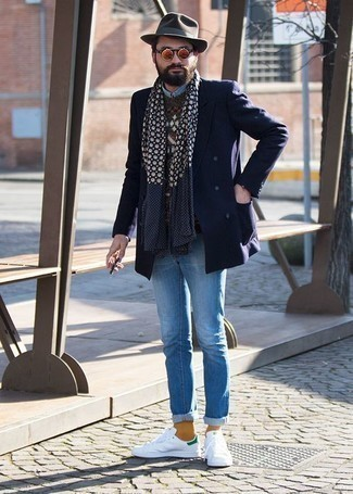 How to Wear Orange Sunglasses For Men: A navy double breasted blazer and orange sunglasses make for the ultimate off-duty style for any man. White and green leather low top sneakers look amazing rounding off your look.