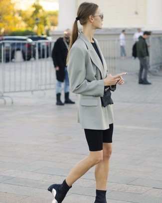 How to wear: grey double breasted blazer, black crew-neck t-shirt, black bike shorts, black elastic ankle boots