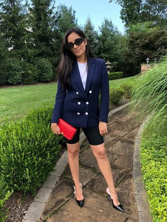 How to wear: navy double breasted blazer, white crew-neck t-shirt, black bike shorts, black leather pumps