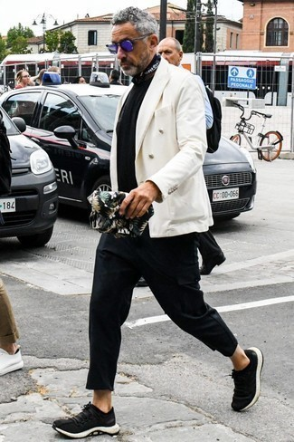How to Wear Black Chinos After 50: For an outfit that's casually smart and camera-worthy, opt for a white double breasted blazer and black chinos. For shoes, you could stick to a more casual route with black athletic shoes.
