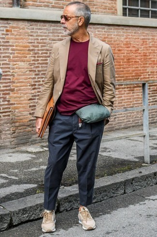 Fashion for Men Over 60: What To Wear: A brown double breasted blazer and charcoal chinos make for the perfect base for an infinite number of smart casual looks. If you wish to easily dial down this getup with a pair of shoes, throw in a pair of tan suede low top sneakers.